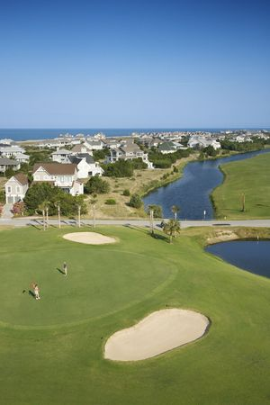 bald head island: Aerial view of golf course in coastal residential community at Bald Head Island, North Carolina.