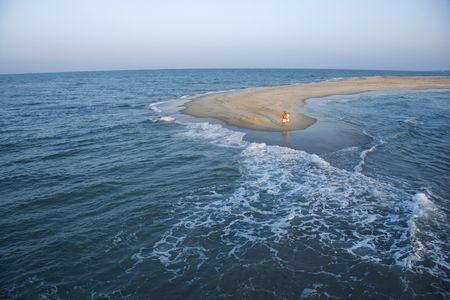 bald head island: Birds eye view of couple on sandbar in Bald Head Island, North Carolina. Stock Photo