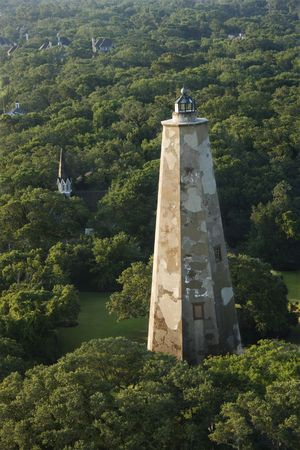 bald head island: Aerial view of Old Baldy lighthouse in wooded park at Bald Head Island, North Carolina. Stock Photo