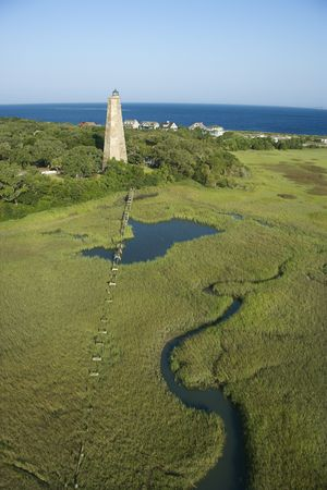 Aerial view of Old Baldy lighthouse in marshy lowlands of Bald Head Island, North Carolina. Stock Photo - 1942765