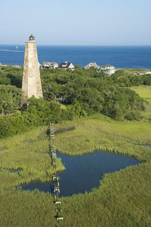 bald head island: Aerial view of Old Baldy lighthouse in marshy lowlands of Bald Head Island, North Carolina. Stock Photo
