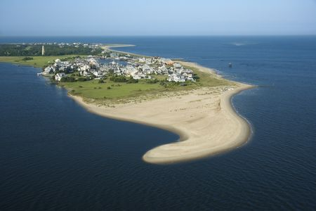 bald head island: Aerial view of beach and residential community on Bald Head Island, North Carolina.