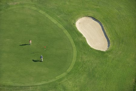 aerial photograph: Aerial view of two people playing golf at Bald Head Island, North Carolina. Stock Photo