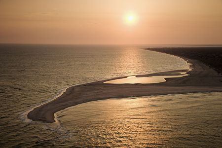 bald head: Aerial view of sun over Atlantic ocean and shoreline of Bald Head Island, North Carolina.