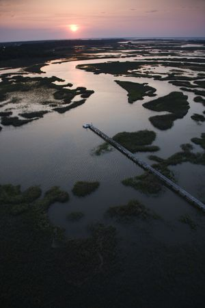 bald head island: Aerial view of pier in coastal wetland on Bald Head Island, North Carolina. Stock Photo