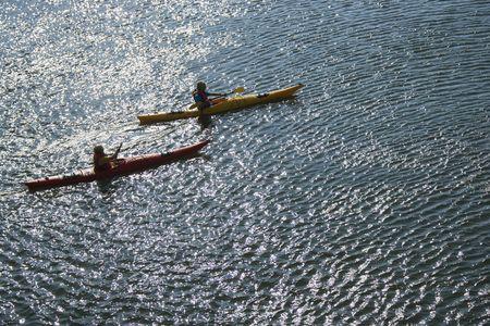 bald head island: Aerial of two teenage boys kayaking on Bald Head Island, North Carolina.