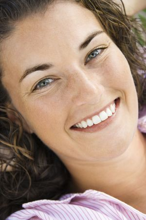 Close up of pretty young adult Caucasian brunette woman smiling at viewer. Stock Photo - 1960862