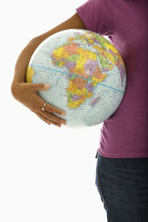 Arm and hips of African American woman holding globe. Stock Photo - 1960844