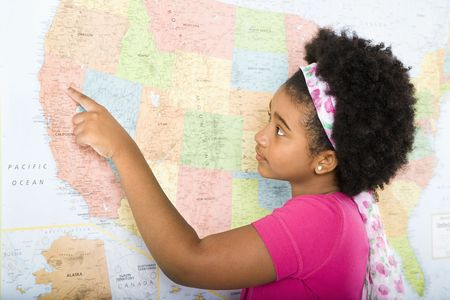 African American girl pointing on map of United States. Stock Photo - 1964092