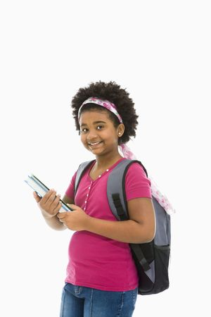 African American girl holding books and wearing backpack smiling at viewer. Stock Photo - 1960717