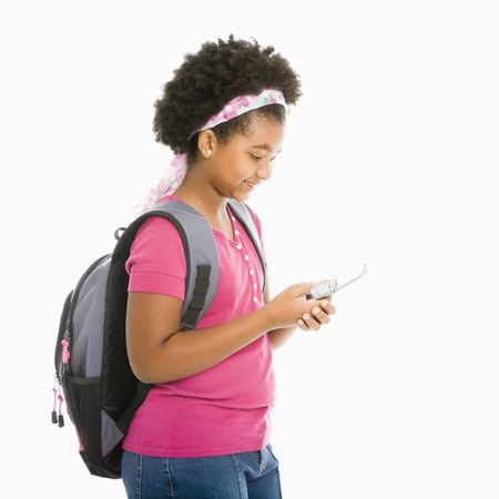 African American girl with backpack text messaging on cell phone. Stock Photo - 1960702