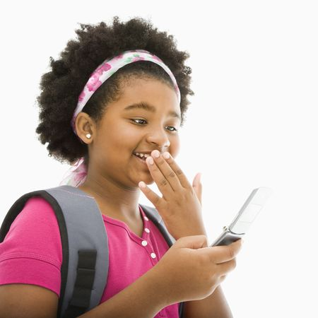 African American girl with backpack talking on cell phone. Stock Photo - 1960845