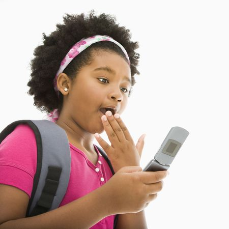 African American girl with backpack looking at cell phone with surprised expression. Stock Photo - 1960846