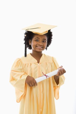 African American girl in graduation robe and hat holding diploma and smiling at viewer. photo