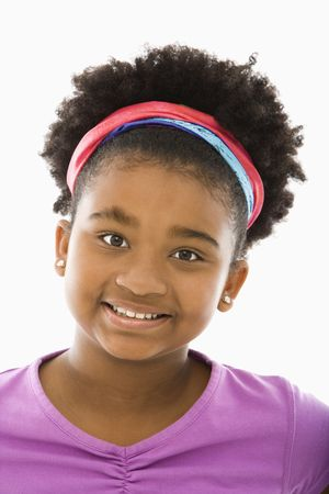 African American girl wearing headband smiling at viewer. photo