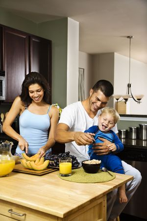 Caucasian family with toddler in kitchen at breakfast. Stock Photo - 1960830