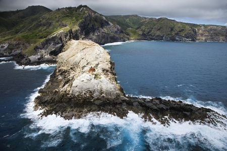 Aerial view of mountains and rocky Maui, Hawaii coastline. photo