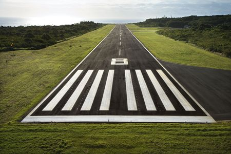 airstrip: Aerial view of paved airplane runway on Maui, Hawaii.