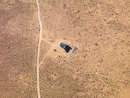 Aerial of house in remote area of Arizona desert. photo