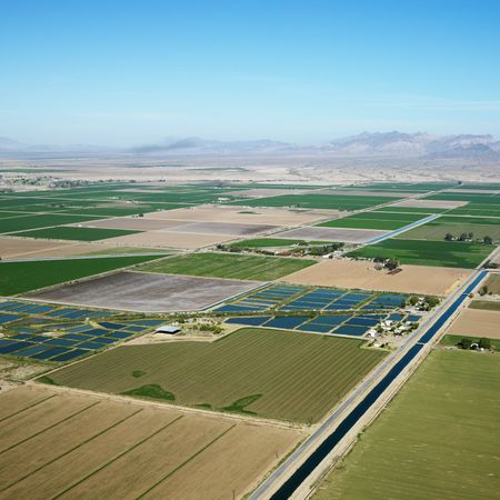 irrigated: Aerial view of cropland and Colorado River Aqueduct in Arizona.