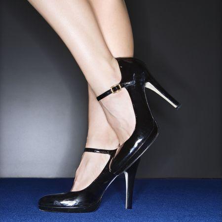 Sexy female legs wearing high heels. Stock Photo - 2029884