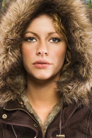 Caucasian young adult woman wearing fur hood looking at viewer. Stock Photo - 2044480
