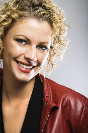 Blond Caucasian young adult woman smiling at viewer. photo