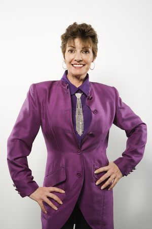 half  length: Half length portrait of pretty middle aged Caucasian woman wearing purple suit with rhinestone necktie.