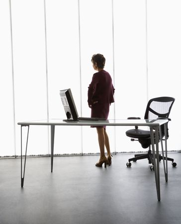 Caucasian middle aged businesswoman standing in office. photo