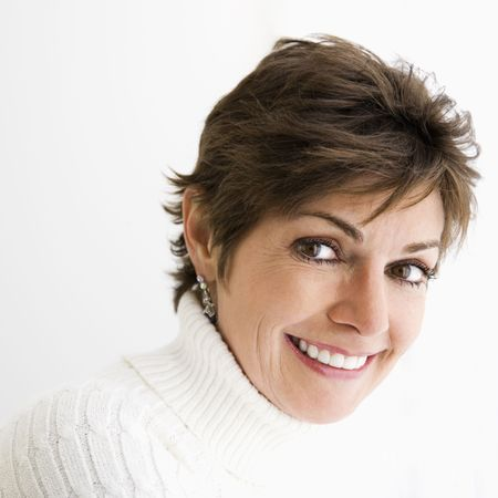 Head and shoulder portrait of pretty Caucasian woman smiling.