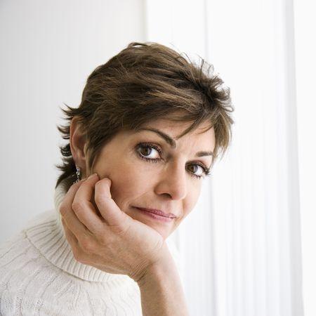 Head and shoulder portrait of pretty Caucasian woman. photo