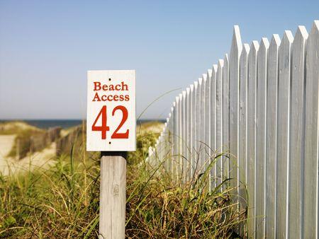 bald head island: Beach access sign with picket fence at Bald Head Island, North Carolina.