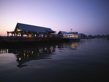 bald head island: Ferry boat at dock at dusk at Bald Head Island, North Carolina. Stock Photo