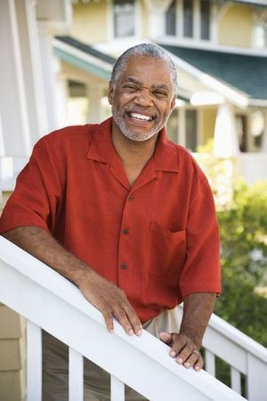 African American middle aged man smiling at viewer and leaning on stairway railing. Stock Photo - 2044294