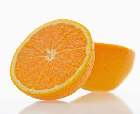 halved: Still life of halved orange against white background. Stock Photo