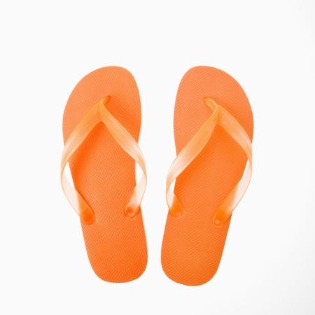 flip flops: Orang plastic thong flip flops. Stock Photo