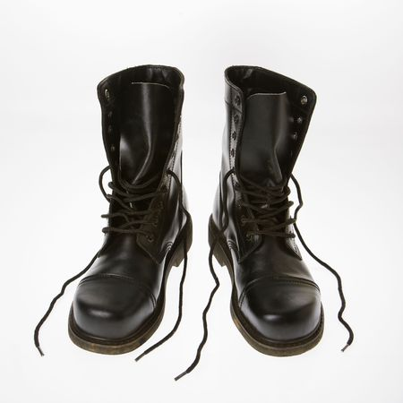 untied: Black leather boots with laces untied. Stock Photo