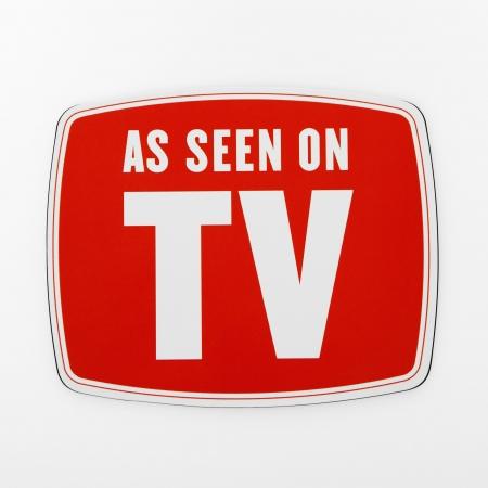 Comme on l'a vu à la télévision signe.  Banque d'images