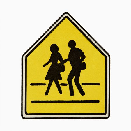 Pedestrian crossing sign against white background. photo