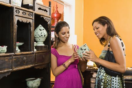 housewares: African American and Indian women shopping together for home decor.