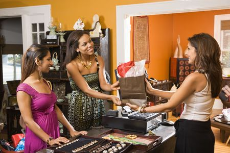 Two women making purchase  from salse clerk in boutique. Stock Photo - 2060825