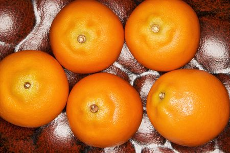 home accents: Five tangerines.