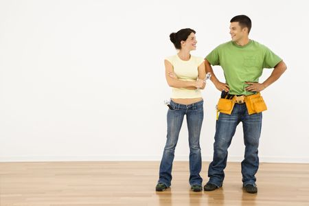 Couple with tools standing and smiling in home. Stock Photo - 2060927