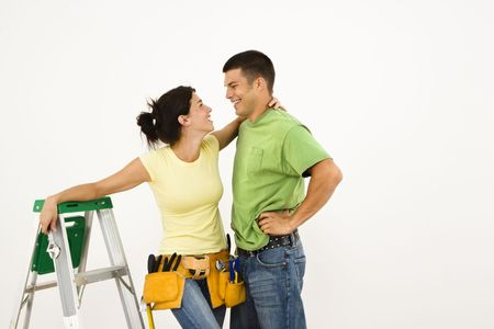 Couple with tools and ladder standing in home smiling. Stock Photo - 2061052