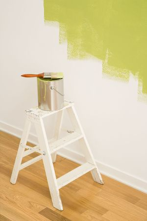Paintbrush on can on top of step ladder with painted wall. Stock Photo - 2043740