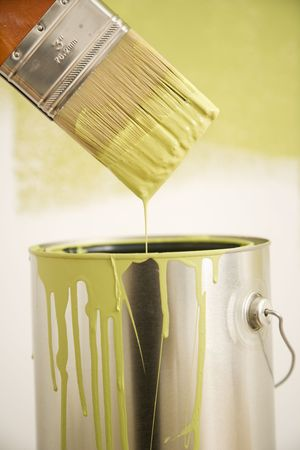 Close up of paintbrush dripping over paint can. Stock Photo - 2061059