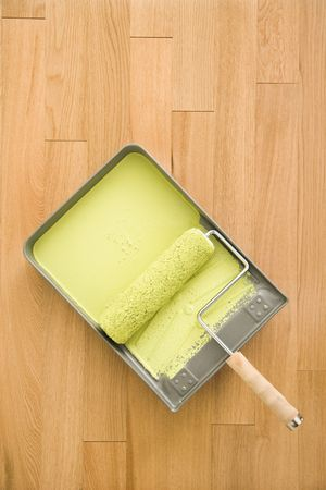 Still life of paint roller in tray on wood floor. Stock Photo - 2061107