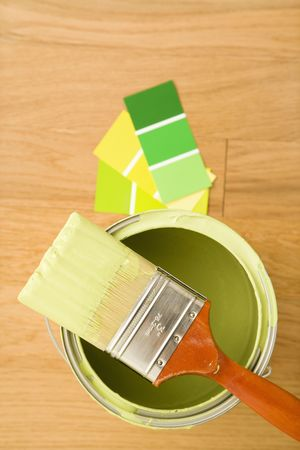 High angle view of paintbrush resting on paint can with color samples. Stock Photo - 2043776