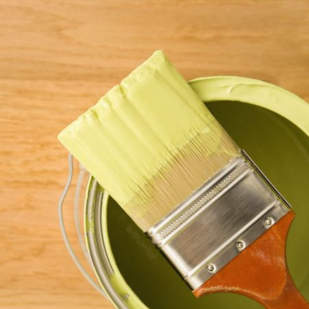 high angle: High angle view of paintbrush resting on paint can. Stock Photo