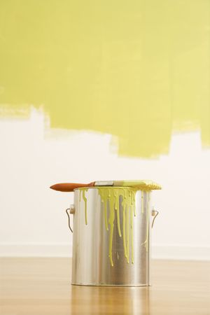 Still life of paintbrush on paint can with painted wall. Stock Photo - 2044018